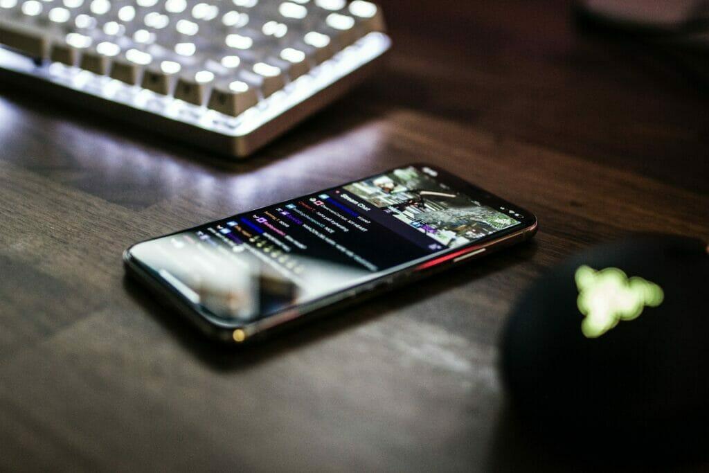 closeup photo of turned on smartphone near keyboard