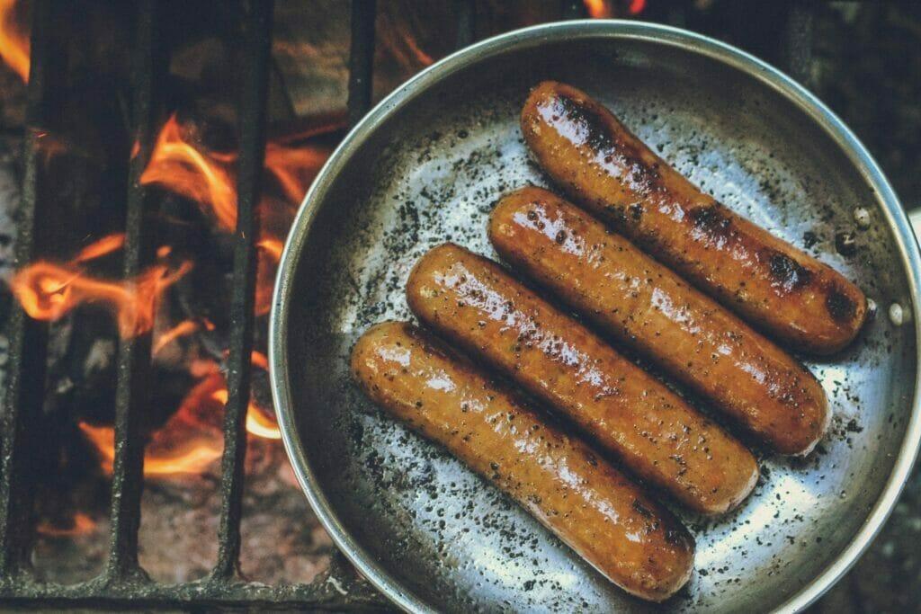 cooked sausage on round grey pan
